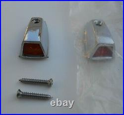 A pair of NOS Mopar 1973-79 fender turn signal chrome cover with lenses 3679255