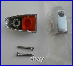 A pair of NOS Mopar 1973-79 fender turn signal chrome cover with lenses 3679255